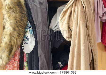 Pile Of Carelessly Scattered Clothes In Wardrobe