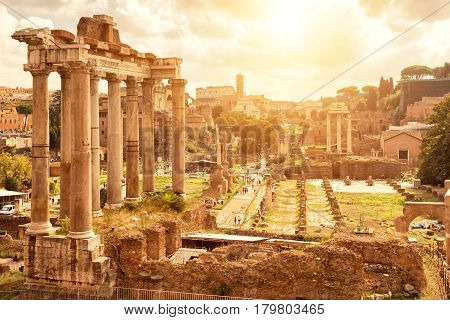 Roman Forum in Rome, Italy. Ruins of the Temple of Saturn in the foreground.