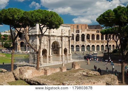 ROME - OCTOBER 10, 2012: Arch of Constantine and Colosseum in Rome, Italy.