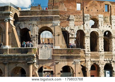 ROME - OCTOBER 4, 2012:  Tourists visiting the Coliseum in Rome, Italy.