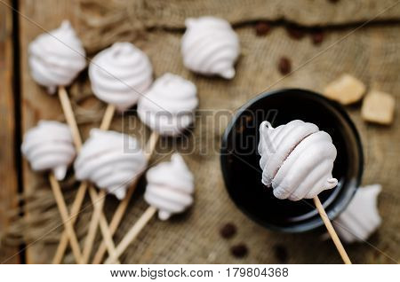 Berries marshmallows with glass of coffee on grey background