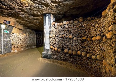 PARIS, FRANCE - SEPTEMBER 25, 2013: The famous Catacombs of Paris, France.