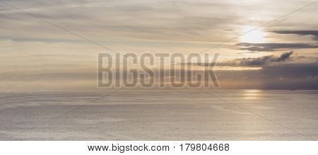 Clouds sky and sunlight sunset on horizon ocean. People on background seascape dramatic atmosphere rays sunrise. Relax view waves water sea mockup nature evening concept perspective ocean sunrise