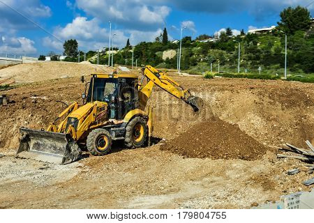 The heavy building bulldozer of yellow color on a white background Tractor bulldozer excavator
