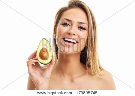 Portrait of attractive adult woman with avocado isolated over white background