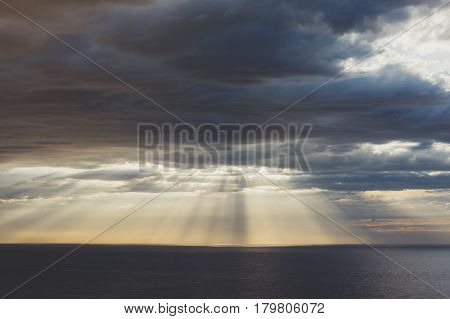 Clouds blue sky and sunlight sunset on horizon ocean . Сloudscape on background seascape dramatic atmosphere rays sunrise. Relax view waves sea mockup nature evening concept.