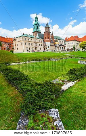 Panoramic view of a Wawel castle and Cathedral with garden in the foreground, Cracow, Poland.