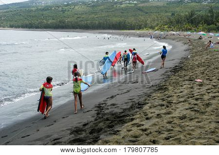 People Walking On The Beach To Join The Surfing Lesson