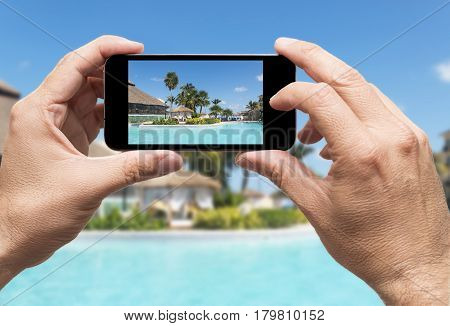 taking picture of vacations in caribbean resort