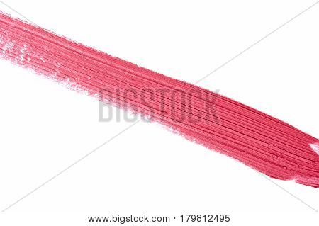 Textured Stroke of pink liquid Lipstick smudged on white Surface
