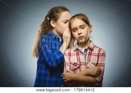 The girl tells the bad news to another girl. Communication concept.