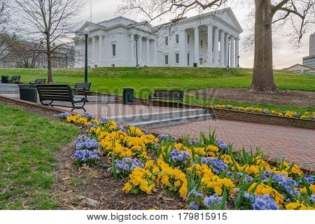 Morning at the Virginia state capitol building in Richmond with flowers.