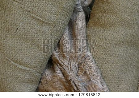 gunny sack brown fabric texture useful as a background