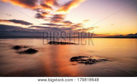Beautiful sunrise on lake Liptovska Mara Slovakia. Long exposure shot with ND filter