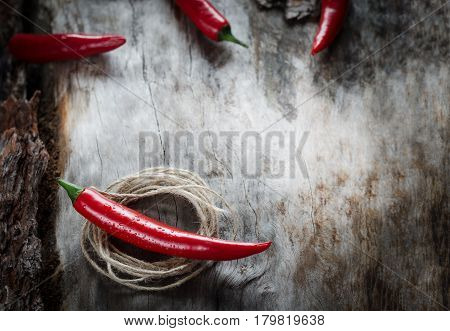 Red Chillies On Aged Wood Background
