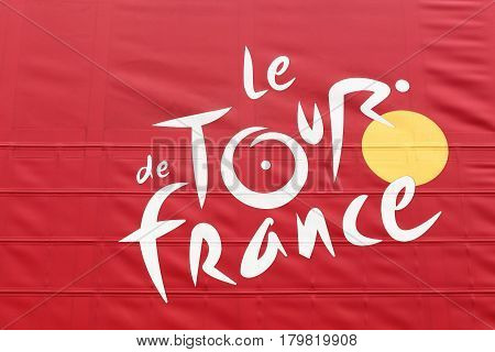 Brouilly, France - March 8, 2017: Tour de France logo on a truck. Tour de France is an annual multiple stage bicycle race primarily held in France