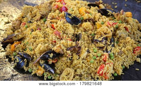 Spanish Paella With Yellow Rice And Mussels And Seafood