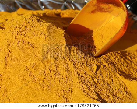 Turmeric Curry Powder Background And A Bailer