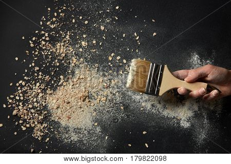 Brush with oat flakes and flour