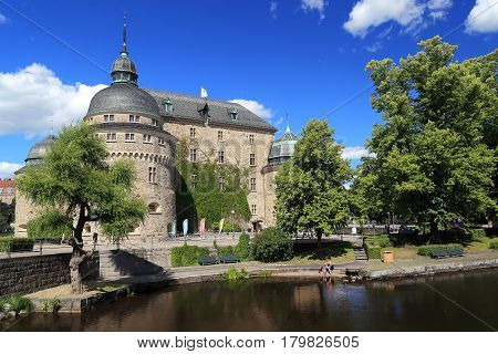 OREBRO, SWEDEN - JULY 7, 2016: The castle of Orebro is a medieval stone building which is one of the most famous and historically significant castles of the Kingdom of Sweden.