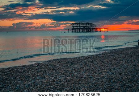 Dramatic sky over Brighton West Pier at sunset