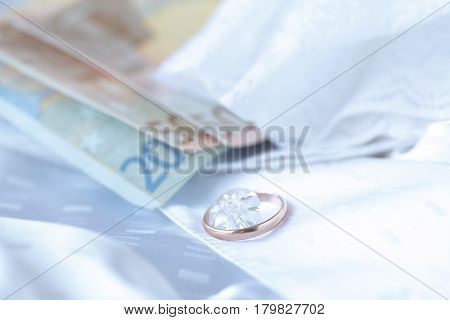 Wedding Dress Lying On A Bed In Bedroom. Bridal Fees.