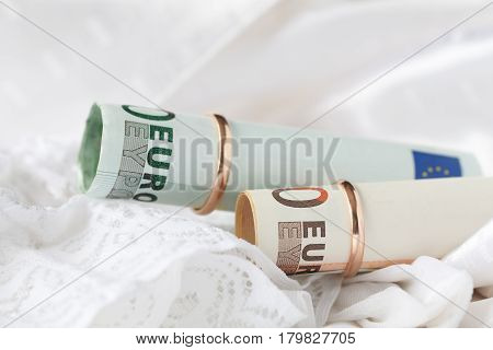 Wedding Ring And Banknotes On Bridal Lace Dress Background. Marriage Of Convenience