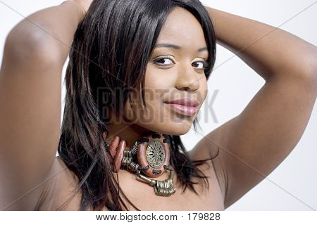 Attractive Young Black Woman Wearing A Wooden Choker
