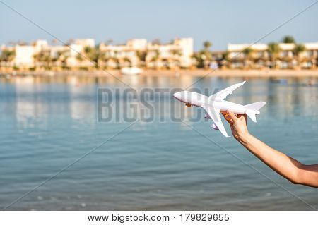 Takeoff Of White Toy Plane In Female Hand