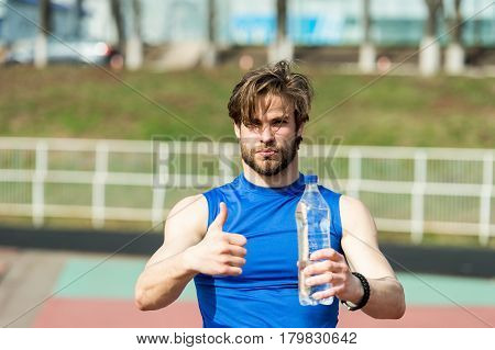 Handsome Muscular Man Holds Water Bottle Showing Thumb Up