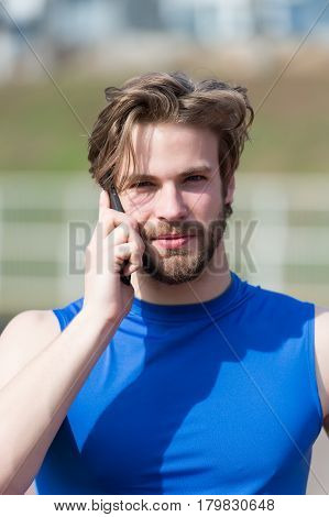 Athletic Bearded Happy Man With Muscular Body Holds Cell Phone