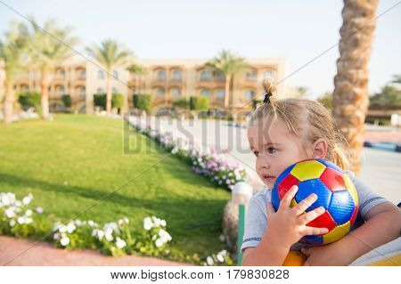 Small Baby Boy With Colorful Ball Playing Outdoor