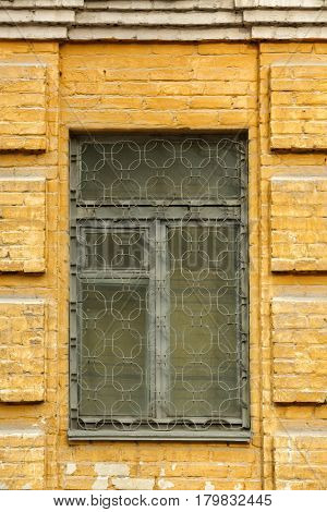 Vintage window and forging with brick wall background