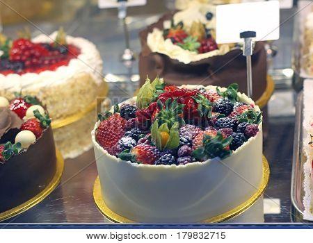 Tasty fruit cake in pastry shop window