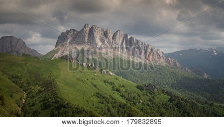 Caucasus mountains (Eastern and Western Acheshbok) under a blue sky with clouds. Caucasus Russia