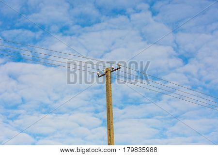 Power Lines On Blue Sky With Clouds Background