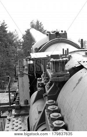 Old gun in old artillery batteries of Fort Krasnaya Gorka in Leningrad region Russia. Black and white.