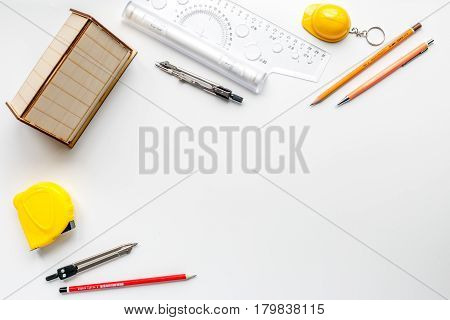 Construction office with architect working tools on white table background top view mockup