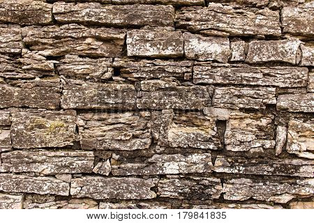 Old masonry made of limestone. Limestone is stratified as a result of atmospheric influences and age.
