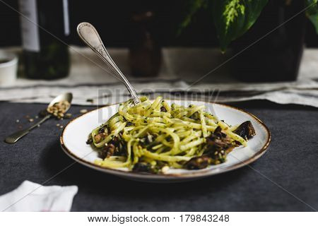 Horizontal View of Plate of Vegetarian Linguine on Slate Table