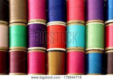 A colorful bobbins of thread as background