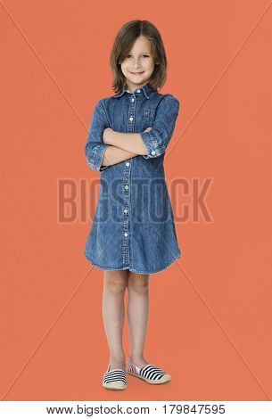 Young white girl kid crossed arms studio full body portrait