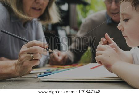 Grandparents with Grandchild Drawing Hobby Concept