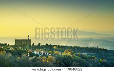 Tuscany Volterra panoramic view landscape and San Giusto Nuovo medieval church at sunset. Italy Europe