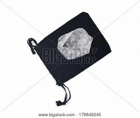 Clear quartz cathedral point on black velveteen crystal pouch isolated on white background