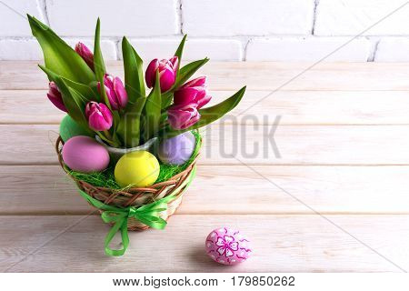 Easter table centerpiece with pastel color hand painted eggs. Happy Easter greeting card. Copy space.