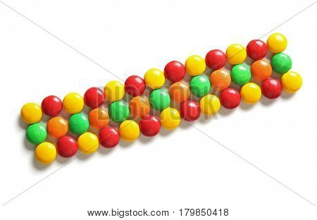Delicious candies on white background