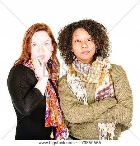 Two unhappy modern women with scarves expressing displeasure