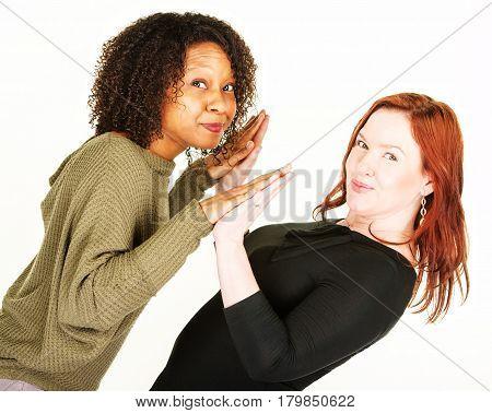 Two Women Touching Palms At Angle