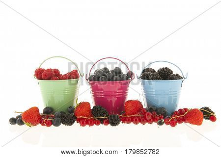 Fresh fruit in colorful glass bowls isolated over white background
